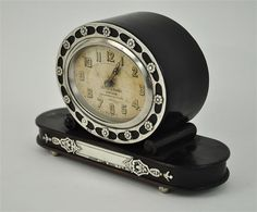 Beautiful mantel clock, rosewood and Portuguese silver case, German movement.
