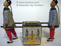 Tin toy windup chinamen toy