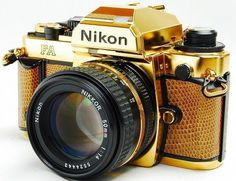 It's not as fancy as a limited Leica, but this gold-plated Nikon FA SLR camera is extremely fancy Antique Cameras, Old Cameras, Vintage Cameras, Nikon Cameras, Nikon Dslr, Canon Lens, Nikon D5100, Camera Gear, Film Camera