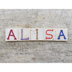 Alisa, Female Name On Carved Travertine Photograph