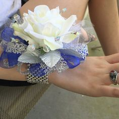 Corsage for prom with single white rose, blue sapphire, and silver ribbon