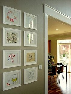 More and more I'm thinking I need a feature wall painted so I can do something like this Great display idea for kid's artwork