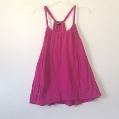 Pink Express Tank (Size Medium) Cotton & Modal. Size Medium. So comfortable! Loose& flowy fir! Fits so many body shapes due to the material and fit! Scoop neck. Express Tops