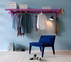 Old wooden ladder, paint it whatever color, can also be used as a coat rack, then store boxes on top to organize gloves, hats, scarfs etc. very clever.