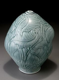 Elaine Coleman.  I think she does this with wax on leaterhard pots.  So beautiful!!!!