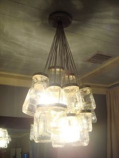 DIY-MASON JAR CHANDELIER.  This would have been the perfect use for all of those canning jars I found cleaning...