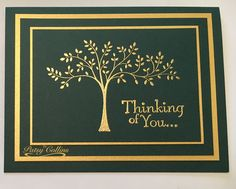 "By Patsy Collins. Apply anti-static powder all over 4 1/8"" x 2 7/8"" dark solid-color cardstock. Stamp tree and sentiment from ""Thoughts and Prayers"" (Stampin' Up) in VersaMark. Heat emboss with gold powder. Set aside.  Layer onto dark green card base: (a) 5"" x 3 3/4"" gold cardstock: (b) 4 3/4 x 3 1/2"" dark solid-color cardstock; (c) 4 1/4"" x 3"" gold cardstock; (d) image panel."