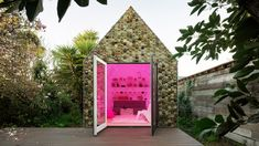 Succulents and other plants grow from the tiles that clad this 3D-printed shed, which was designed to offer a solution for the Bay Area's housing shortage.