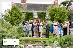 Wedding guests during drinks reception at Lyde Arundel by the lovely Russell Lewis www.russelllewisphotography.co.uk