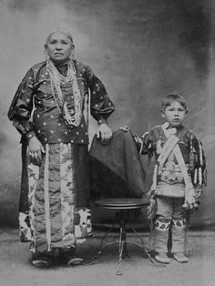 Winnebago Indian woman and boy photographed in Wisconsin circa 1900.