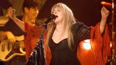 Stevie    ~ ☆♥❤♥☆ ~ looking gorgeous in red, performing at a private show to introduce the release on May 2001 of her 'Trouble in Shangri-la' album, her first solo collection since 1994, at SIR Studios in Los Angeles, California; photo by Frank Micelotta/ImageDirect