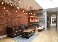 Love the brick wall and hanging lights, just like our office.  Would be great to recreate that.