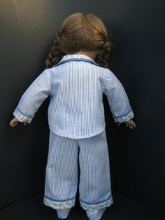 Your American Girl doll will stay warm and cozy in these cheerful blue pin stripe pajamas which also come with blue piping on the collar, pocket and cuffs. The top and pants are both made of cotton fabric. The pants fit snugly with an elastic waistband, and the top closes with