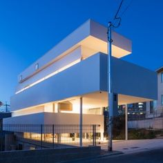 Tato Architects breaks up the volume of House in Toyonaka into seven stripes