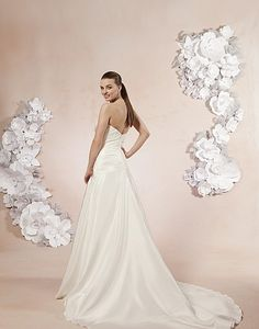 Sweetheart / Wedding Gowns / Style #5984 / Available Colours : All Ivory, White - A strapless, taffeta, A-line gown with a draped asymmetric drop waist accented with beading at the hip and the neckline. Buttons cover the back zipper and this style has a sweep train (back)