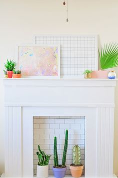This DIY faux fireplace is made from tongue and groove planks, MDF board and subway tile. It's a great way to add a space for art, seasonal decorations and potted plants in a home or apartment that doesn't have a fireplace. Pick it up and take it with you when you move. See the tutorial by Lexy Ward, of the blog PROPER. || @theproperblog