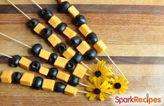 """Black & Orange Halloween Party Kebabs: Alternate black olives and orange cheese cubes on a skewer for a simple, healthy and delicious """"finger"""" food that fits the holiday theme! 