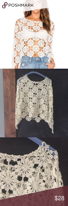 MinkPink build me up crochet top Size L EUC Adorable mink pink crochet top build me up. It is so versatile! Wear it over your bathing suit in the summer or over a tank or over a turtle neck in the winter for a boho hippie vibe.. either way  MINKPINK Tops