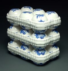 Deceptive Decadence, slip cast ceramic food packages with decals, 2012
