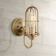 Warm and industrial, this bright wall sconce is finished in dark antique brass with an open shade design. Brass Bathroom Sconce, Brass Sconce, Bathroom Wall Lights, Bathroom Light Fixtures, Bathroom Lighting, Black Wall Sconce, Rustic Wall Sconces, Modern Wall Sconces, Gold Home Accessories