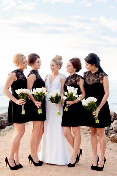 Black and white wedding - bridesmaids in black with white bouquets. Photo by Karen Buckle.