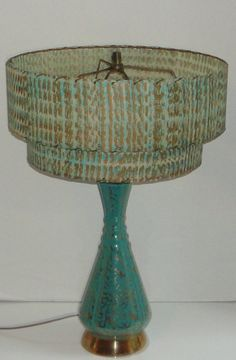 I have one very similar that I will be listing soon with better Retro Art Deco Decor lines, love these hot colors! Super Cool 1950's Turquoise and Gold Lamp with shade http://www.etsy.com/listing/100357292/super-cool-1950s-turquoise-and-gold-lamp