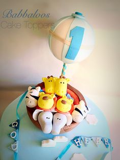 Babbaloos cakes - hit air balloon - Noah's ark - animals - first birthday cake