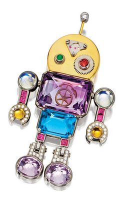 *WHIMSICAL GEM-SET AND DIAMOND 'ROBOT' BROOCH, KUNG TSUNG TZU Designed as a robot, the body decorated with an inverted amethyst and topaz weighing approximately 13.00 and 6.50 carats respectively, the limbs set with calibré-cut rubies, amethyst, cabochon moonstones, citrines, and diamonds, accented by a cabochon emerald-set eye, further enhanced by a brilliant-cut diamond-set antenna, mounted in 18 karat white and yellow gold, pendant fitting, signed.