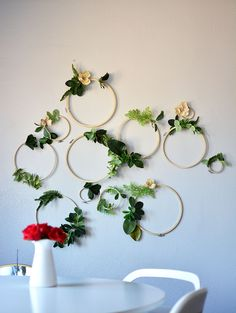 Gold Hoops with flowers hanging on the wall