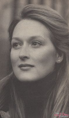 saw a vision of Meryl Streep with long brunette hair, in her youth still, with her eyes closed while she stood in front of a chocolate wood oval mirror.