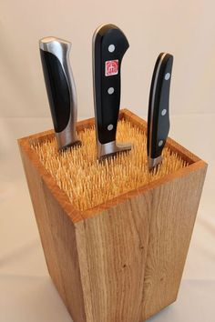 DIY knife block. Maybe use spaghetti in a vase or a wooden box like pictured.  | followpics.co