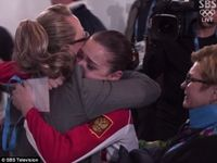 The Russian women's figure skating judge -- who just happens to be married to the president of Russia's figure skating federation -- was caught backstage hugging the 17-year-old Russian skater who was awarded a controversial gold medal on Thursday after she received what some said were inflated scores in a performance that saw her stumble.
