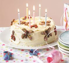 Birthday bug cake. Children will love the butterfly and ladybird decorations on this colourful cake – and you'll love its simplicity