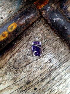 sugilite tension set in hand forged polished sterling silver pendant