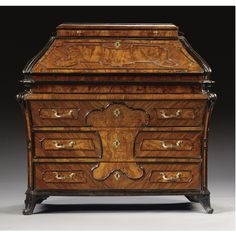 A LOMBARD BURR WALNUT VENEERED BUREAU, THIRD QUARTER 18TH CENTURY.