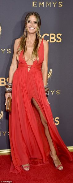 Sultry:Heidi also chose a Peter Dundas dress with a deep slit; the mother of four stunned in her crimson number