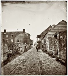 Shorpy Historical Photo Archive :: Six men and a horse in this St. Augustine, Florida, street view from around 1865.