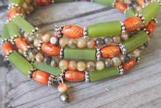 Memory Wire Bracelet in Green and Orange, made of Natural Stone and Wood, Wide Cuff, Stacked, Wrap Around Bracelet. $24.00, via Etsy.