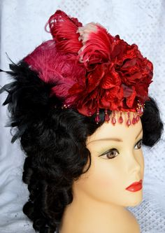 "Beautiful satin tear drop hat with velvet flowers, ostrich feathers,  - black cock feathers and net bow decorate the back. Find in my Etsy store --""hatsbymaryann"" SOLD"