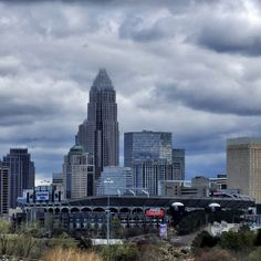 Bank of America Stadium, home of the Carolina Panthers NFL franchise, sits in front of the Charlotte skyline. Charlotte Skyline, Charlotte Nc, Charlotte Panthers, Bank Of America Stadium, Panthers Football, Carolina Panthers, North Carolina, New York Skyline, Coastal