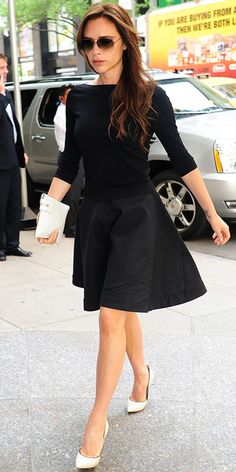 Victoria Beckham in Diane Von Furstenberg sweater, Victoria Beckham Collection skirt and sunglasses, and Casadei pumps