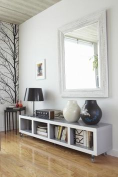 Double the amount of sunlight in your room by allowing it to bounce off reflective surfaces. Hang a large mirror directly across from the largest window in your room, or arrange an array of smaller mirrors to help brighten a dark staircase. Dark Living Rooms, Living Room Decor, Living Spaces, Tiny Living, Low Bookcase, Ikea Bookcase, Low Shelves, Bookcases, Brighten Room