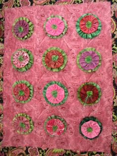 Quilted wall hanging by Laraine Wells.