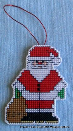 This pattern from Quick & Easy Magazine was perfect for creating a hangable Christmas tree decoration.. I made this one in cross stitch on a 14ct plastic canvas rectangle using DMC stranded cotton. Then I cut very carefully around Santa leaving one line of canvas intact all round, which I oversewed in white perle.