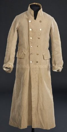 1800-1820 DescriptionMan's overcoat. Handsewn of golden tan wool with green wool and linen blend partial lining. Double breasted, with 2 rows of 6 brass buttons; the top button in each row has engraved flowers. Round neckline with high standing collar. Long sleeves with turned back cuffs. Slightly flared skirt. Two wide flap pockets curving around hips. Long length (below knee). Back of coat has center seam and 2 curving side seams that open at waist in reinforced box pleats. (Keywords…