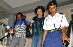 Picture of a Chinese national accused of wildlife trafficking being escorted by Tanzanian police