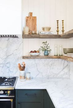 sage green cabinets, a white and grey marble backsplash and countertops and raw open wooden shelves Kitchen Tiles Design, Kitchen Wall Tiles, Kitchen Cabinet Design, Kitchen Backsplash, Interior Design Kitchen, Kitchen Cabinets, Kitchen Storage, Corner Shelves Kitchen, Shaker Cabinets