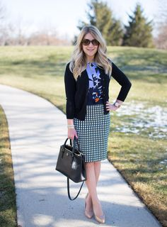 A grid print pencil skirt is paired with a floral shell and black cardigan for a chic work look that incorporates pattern mixing, work doesn't mean boring!