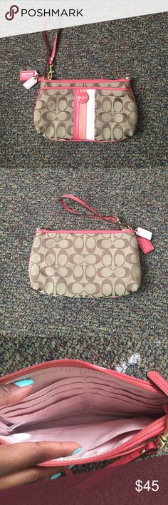 Coach wristlet Large coach wristlet, only used a couple of times. In good condition. Reasonable offers accepted 💋 Coach Bags Clutches & Wristlets