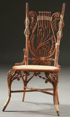 A VICTORIAN WICKER MUSIC CHAIR circa 1900; with o